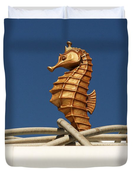 Duvet Cover featuring the photograph Golden Seahorses by Art Block Collections