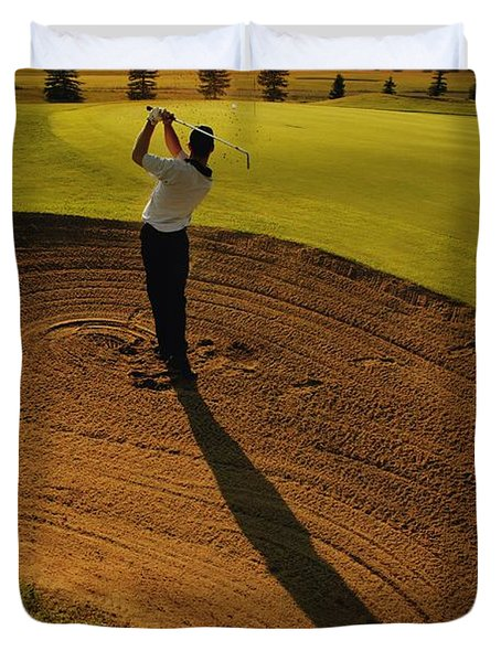 Golfer Taking A Swing From A Golf Bunker Duvet Cover by Darren Greenwood