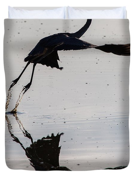 Great Blue Heron Takeoff Duvet Cover by John Daly