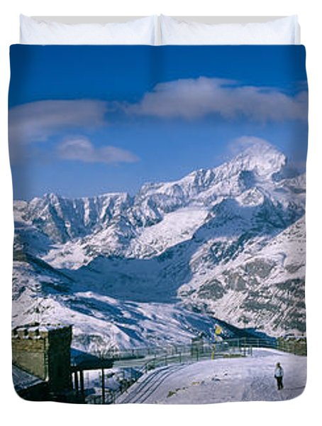 Group Of People Skiing Near A Mountain Duvet Cover