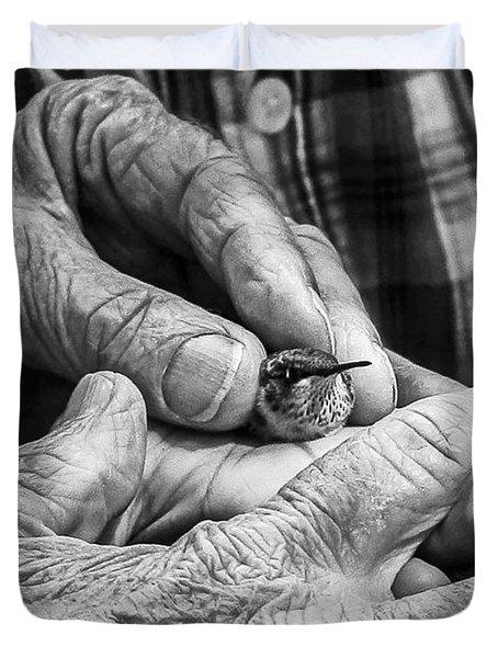 Hands Holding A Hummingbird Duvet Cover