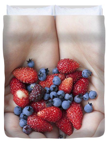Hands Holding Berries Duvet Cover
