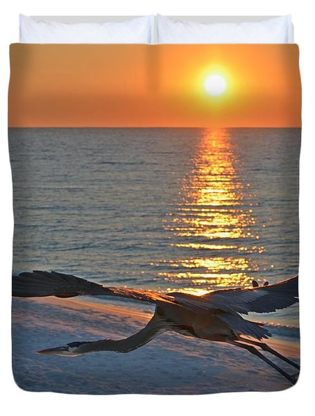 Duvet Cover featuring the photograph Harry The Heron Takes Flight To Reposition His Guard Over Navarre Beach At Sunrise by Jeff at JSJ Photography