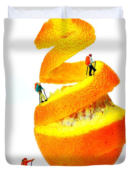Hikers Climbing Orange Mountain Duvet Cover by Paul Ge