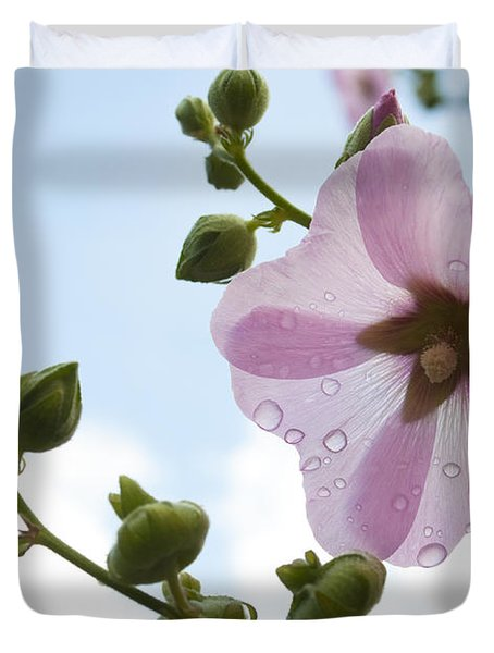 Duvet Cover featuring the photograph Hollyhock With Raindrops by Lana Enderle
