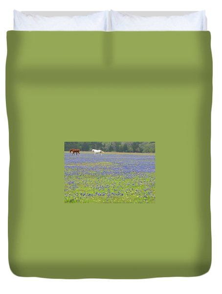 Horses Running In Field Of Bluebonnets Duvet Cover by Connie Fox