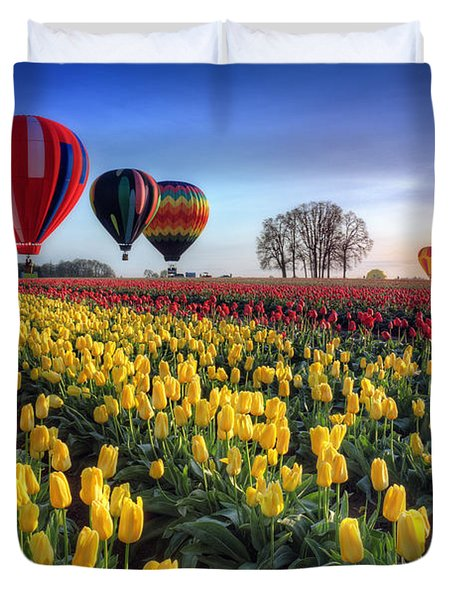 Duvet Cover featuring the photograph Hot Air Balloons Over Tulip Fields by William Lee
