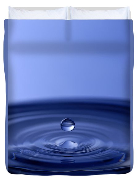 Hovering Blue Water Drop Duvet Cover by Anthony Sacco