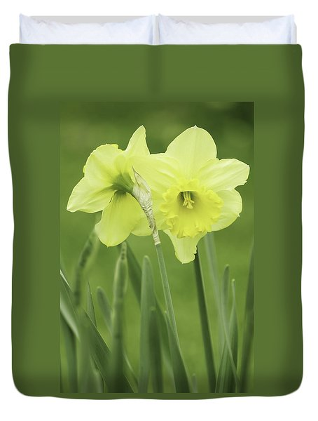 Duvet Cover featuring the photograph Hugging Daffodils by Ram Vasudev
