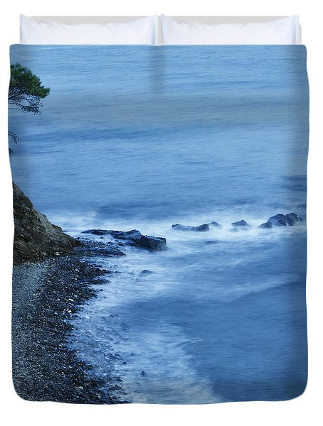 Isolated Tree On A Cliff Overlooking A Duvet Cover by Ken Welsh
