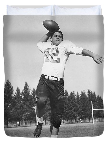 Joe Francis Throwing Football Duvet Cover by Underwood Archives