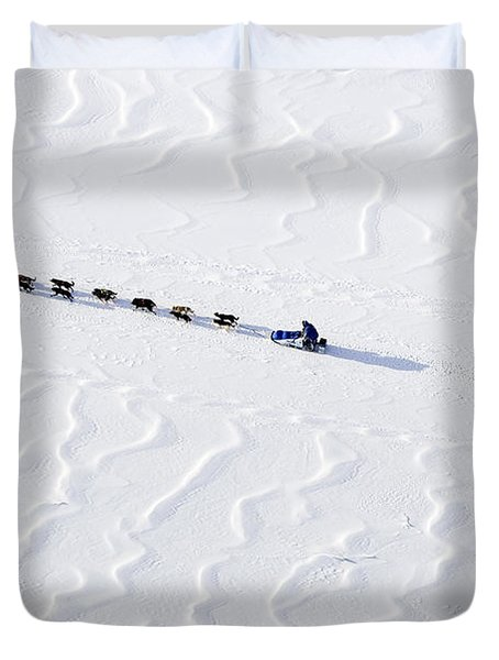 John Bakers Team Running Down Frozen Yukon River  Duvet Cover by Jeff Schultz