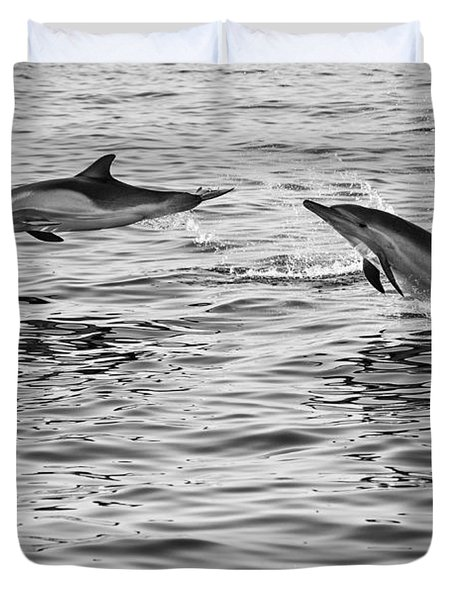 Jump For Joy - Common Dolphins Leaping. Duvet Cover by Jamie Pham