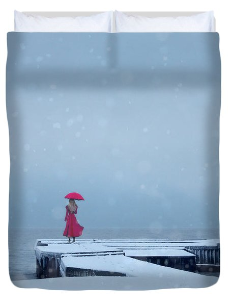 Lady In Red On Snowy Pier Duvet Cover