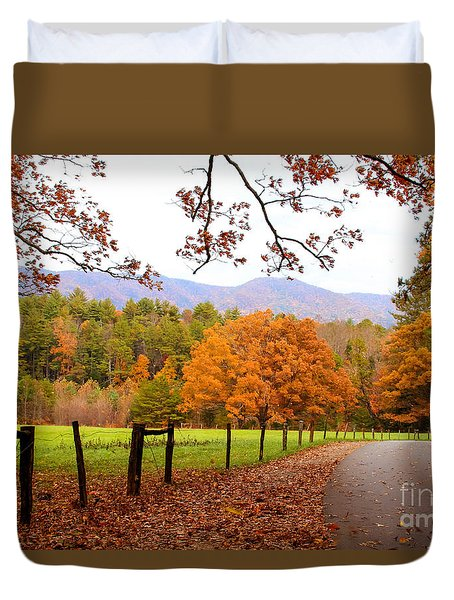 Duvet Cover featuring the photograph Leaves A'fallin by Geraldine DeBoer