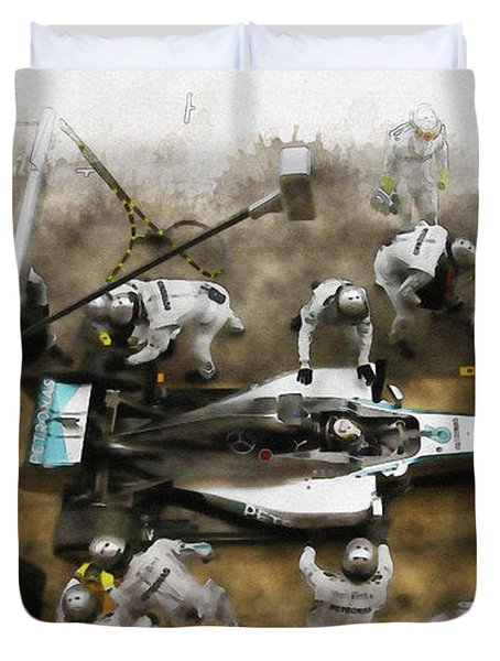 Lewis Hamilton Of Britain Service The Car At Pit Stop Duvet Cover
