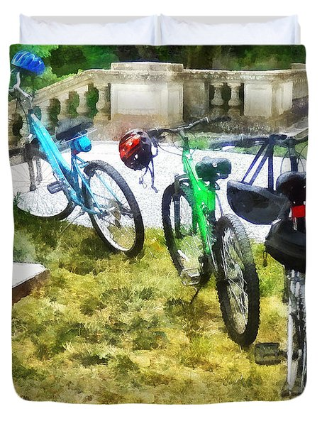 Line Of Bicycles In Park Duvet Cover by Susan Savad