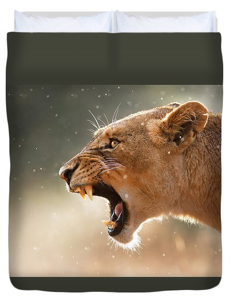 Lioness Displaying Dangerous Teeth In A Rainstorm Duvet Cover