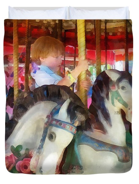 Little Boy On Carousel Duvet Cover by Susan Savad