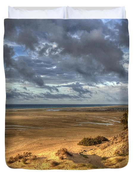 Lone Stroller On A Vast Beach Under Dramatic Sky Duvet Cover by Julis Simo