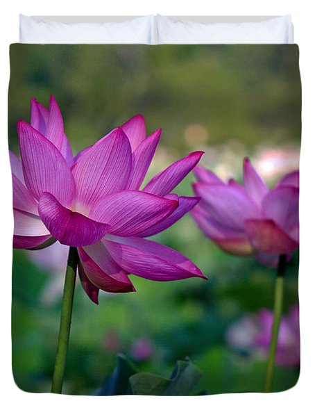 Duvet Cover featuring the photograph Lotus Flowers by Jerry Gammon