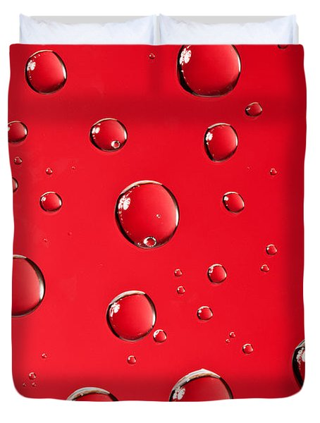 Macro Water Drop On Red Duvet Cover by Sharon Dominick