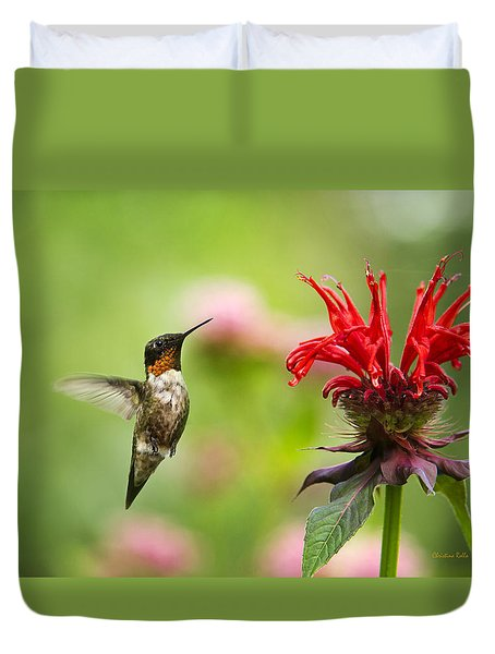 Male Ruby-throated Hummingbird Hovering Near Flowers Duvet Cover by Christina Rollo