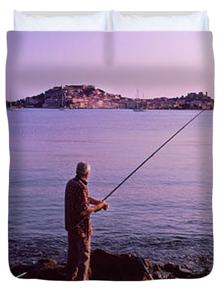 Man Fishing At The Coast, Portoferraio Duvet Cover