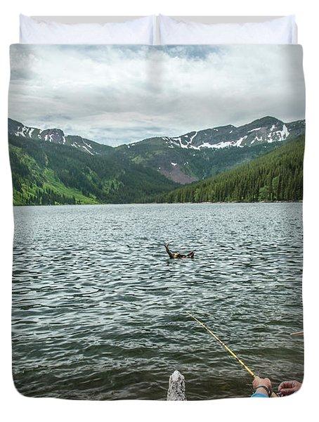 Man Fishing Flotilla Lake, Montana Duvet Cover