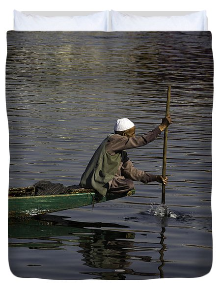Man Plying A Wooden Boat On The Dal Lake Duvet Cover