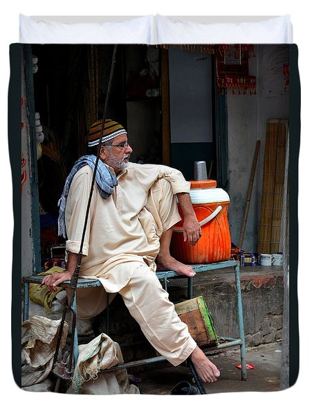 Man Sits And Relaxes In Lahore Walled City Pakistan Duvet Cover