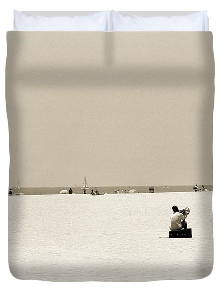 Man Sitting On A Beach Playing His Horn Duvet Cover by Stephen Spiller