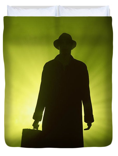 Duvet Cover featuring the photograph Man With Case In Green Light by Lee Avison