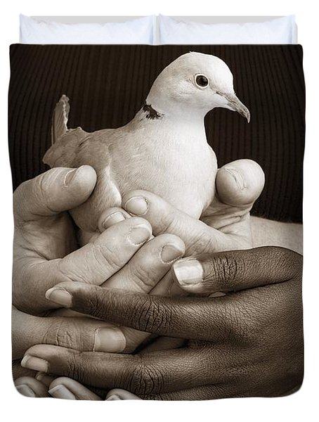 Many Hands Holding A Dove Duvet Cover by Ron Nickel