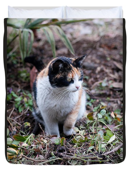 Duvet Cover featuring the photograph Mochi In The Garden by Laura Melis