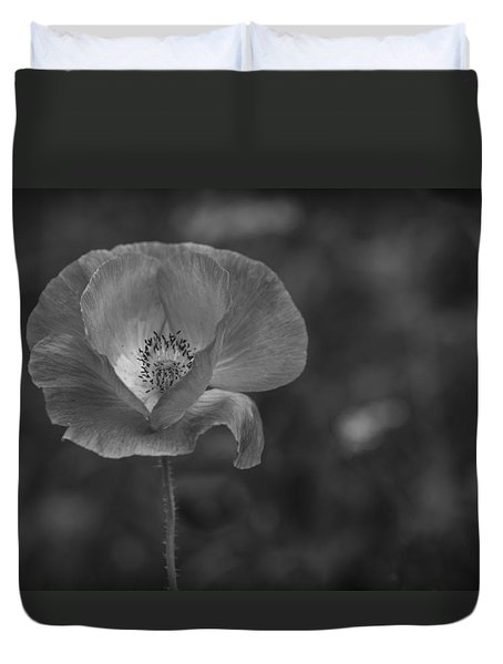 Duvet Cover featuring the photograph Monochrome Poppy. by Clare Bambers