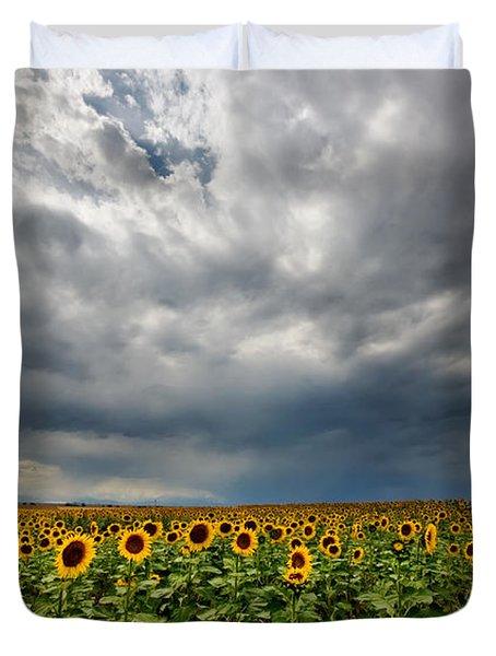 Moody Skies Over The Sunflower Fields Duvet Cover