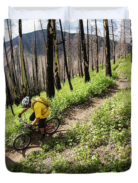 Mountain Biking In Wooded Trail Duvet Cover
