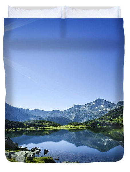 Muratov Lake Against Blue Sky Duvet Cover by Evgeny Kuklev