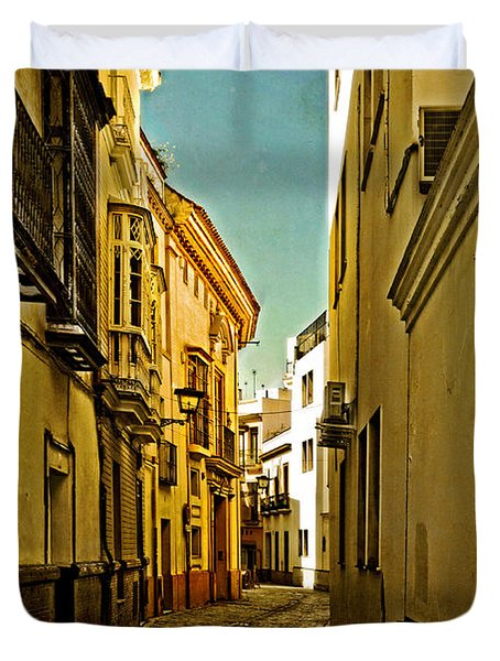 Narrow Street In Seville Duvet Cover by Mary Machare