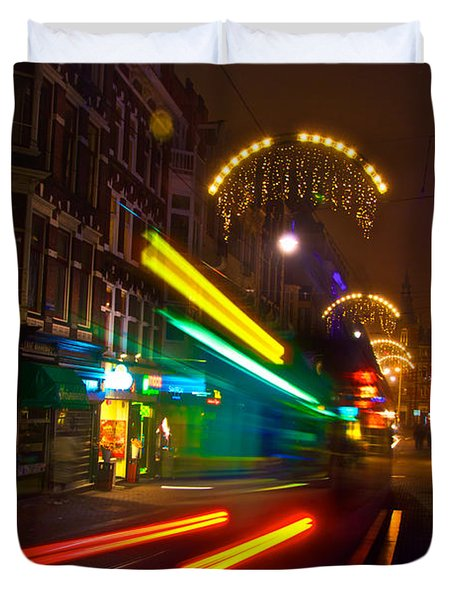 Duvet Cover featuring the photograph Neon Tram Leidestraat by Jonah  Anderson