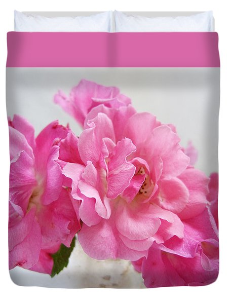 Duvet Cover featuring the photograph No Ordinary Roses by Louise Kumpf