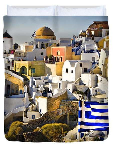 Duvet Cover featuring the photograph Oia And A Greek Flag by Meirion Matthias