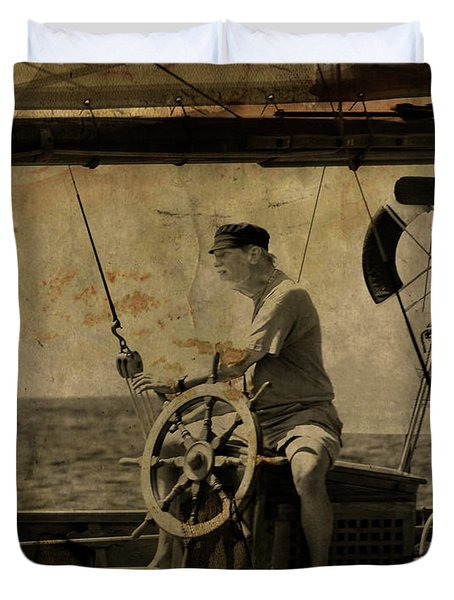 old sailor A vintage processed photo of a sailor sitted behind the rudder in Mediterranean sailing Duvet Cover