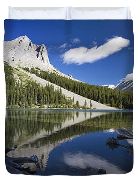 Panorama Of A Mountains Reflecting On A Duvet Cover by Michael Interisano