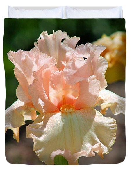 Peach-colored Iris Duvet Cover by Karen Adams