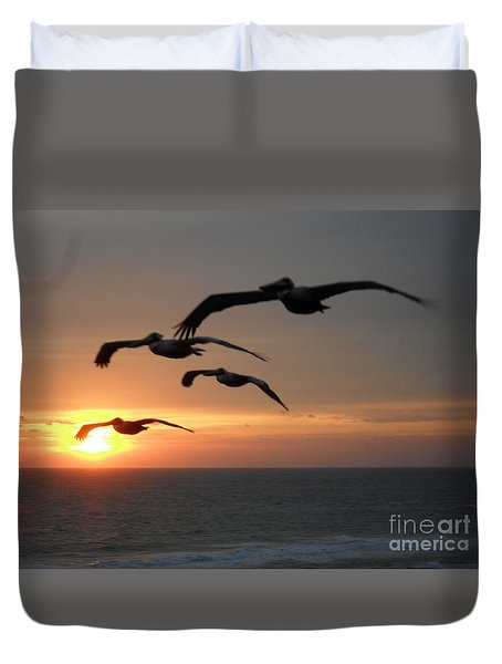 Duvet Cover featuring the photograph Pelican Sun Up by Laurie Lundquist