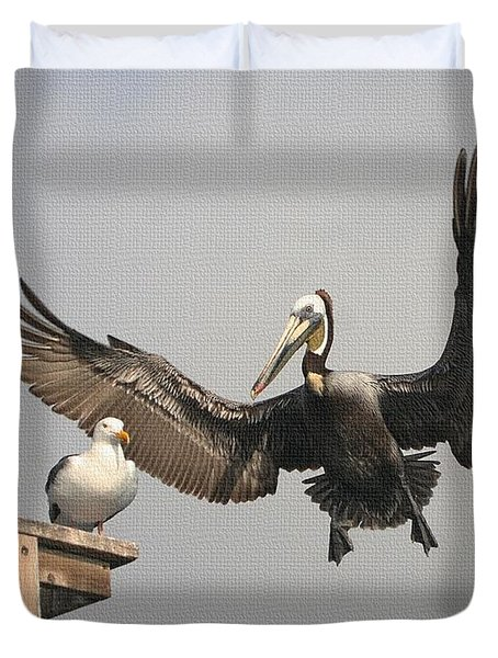Duvet Cover featuring the photograph Pelican Wins Sea Gull Looses by Tom Janca