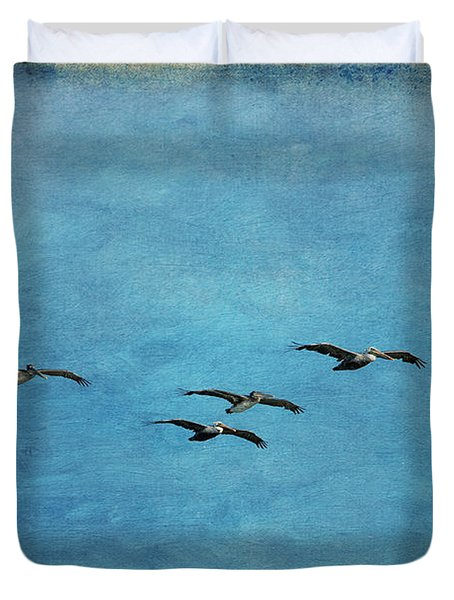 Pelicans In Flight Duvet Cover