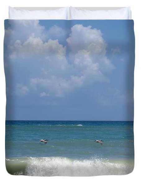 Pelicans Over The Ocean Duvet Cover